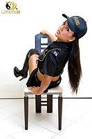 Sporty cutie in police uniform stroking cock