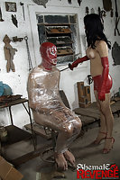 Adriana Rodrigues and her masked slave