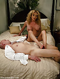 Gia Darling gives footjob to a bald guy