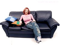 Busty Shemale In Stockings Shows Big Cock On Sofa