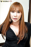 Asian tranny MILF unloads her smooth balls