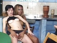 Sexy black Tgirl in threeway action