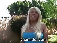 Blonde beauty with huge breasts solo