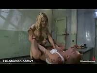Shackled guy fucked by blonde tranny