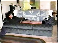 CD solo on a sofa