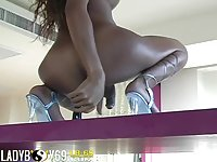 Beautiful tanned ladyboy plays with toys