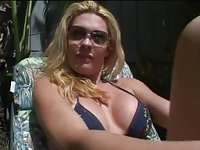 Culy blonde rests in the pool