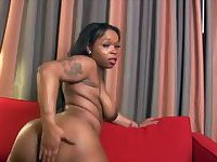 Black tranny wanks off her cock