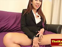 Thai business ladyboy plays with her ass