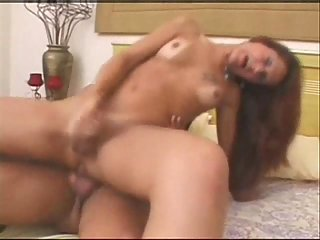 Redhead and brunette shemales share one dick