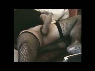 Sissy In Black Stockings With A Dildo