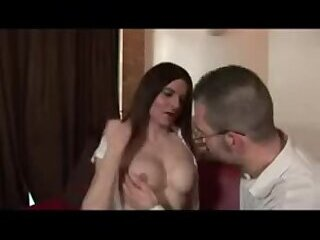 Busty brunette fucks with man on a couch