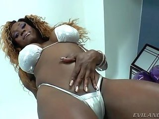 Busty ebony chick in white lingerie
