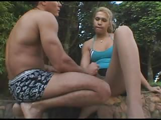 Blonde tranny & guy do handjob for each other