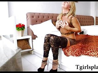 Blonde shemale in fishnets lingerie masturbates her big hard cock