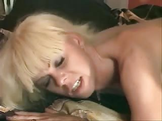 Chap penetrated a blonde Tgirl in black stockings