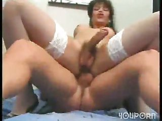 Brunette tranny fucked in white stockings