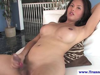 Exotic busty shemale plays with self