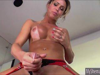 Huge boobs shemale Rakel jerks off cock