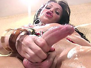 Latina t-girl with nice big tits jerks off her massive cock