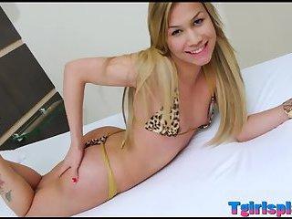 Cute blonde shemale masturbates her cock